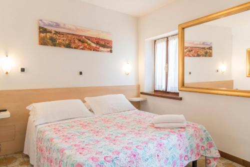 A bed or beds in a room at Albergo Trento