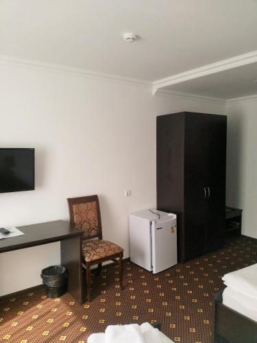 A television and/or entertainment center at Аtria Hotel
