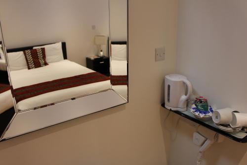 Cama o camas de una habitación en Abbey Court Hotel - Hyde Park