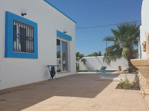 The swimming pool at or near Dar Cesar