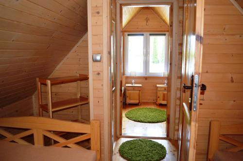 A bunk bed or bunk beds in a room at Bajkowe Domki