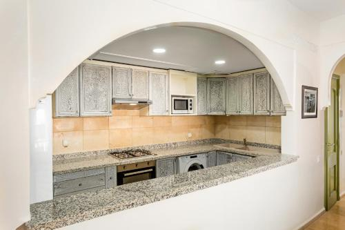 A kitchen or kitchenette at 2 Bed Apartment, L'Hivernage, The Bardot, Rooftop Pool
