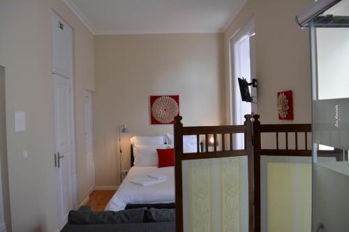 Uma cama ou camas num quarto em Paço 100 Pressa