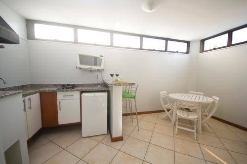 A kitchen or kitchenette at Metropolis Apart Hotel