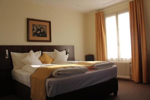Gulta vai gultas numurā naktsmītnē Gasthaus zum Kreuz