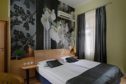 A bed or beds in a room at Hotel Scaletta
