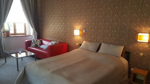 Postel nebo postele na pokoji v ubytování Hotel Merlot