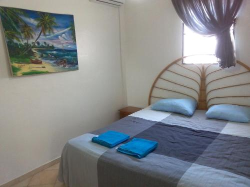 A bed or beds in a room at Apartment in Sosua Center