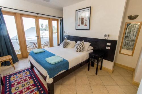 Cama ou camas em um quarto em Red C Villas