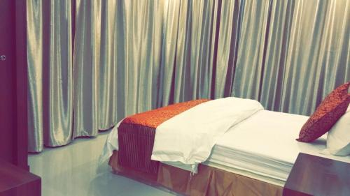 A bed or beds in a room at Lilas Taif