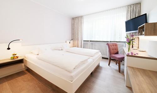 Ein Bett oder Betten in einem Zimmer der Unterkunft Park Hotel