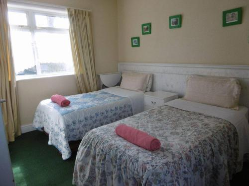 A bed or beds in a room at Bramley House