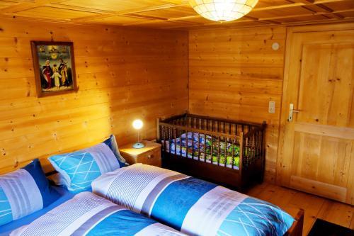 Ein Bett oder Betten in einem Zimmer der Unterkunft Landhaus Tenne
