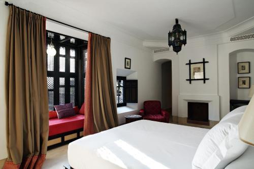 Un ou plusieurs lits dans un hébergement de l'établissement Dixneuf La Ksour