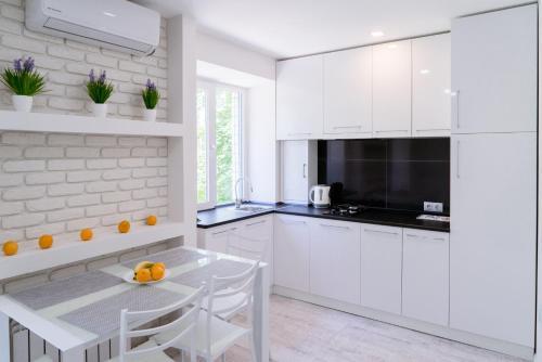 A kitchen or kitchenette at 2nd floor apartment - Ushakova street
