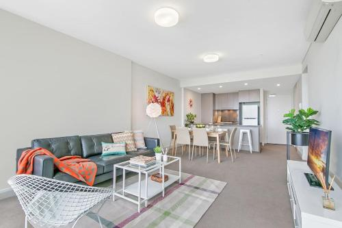 A seating area at NOP007-24 Olympic Park 2Bed2 Bath High Level View