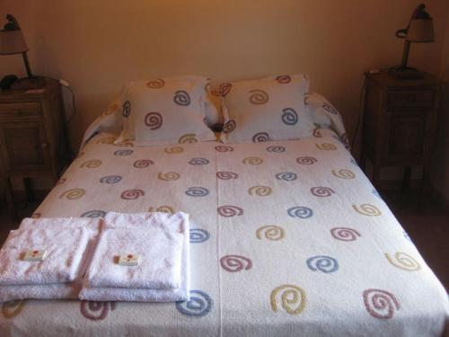 Una cama o camas en una habitación de Apart Hotel Tierra Nativa