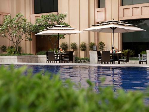 The swimming pool at or near The Metropolitan Hotel & Spa New Delhi