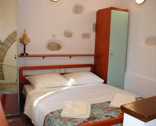 A bed or beds in a room at Casa di Nives