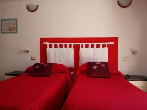 A bed or beds in a room at Ada's Guest house