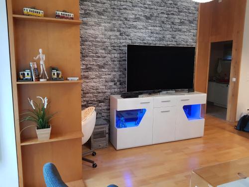 A television and/or entertainment center at La PERLE de Lisbonne !