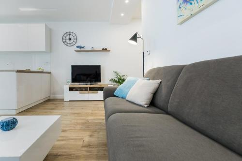 A seating area at Apartment Perla