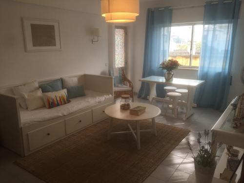 A seating area at Fuzeta beach holiday apartment
