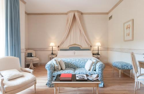 A bed or beds in a room at Eugenia de Montijo, Autograph Collection