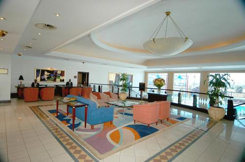 A restaurant or other place to eat at Carnival City Hotel