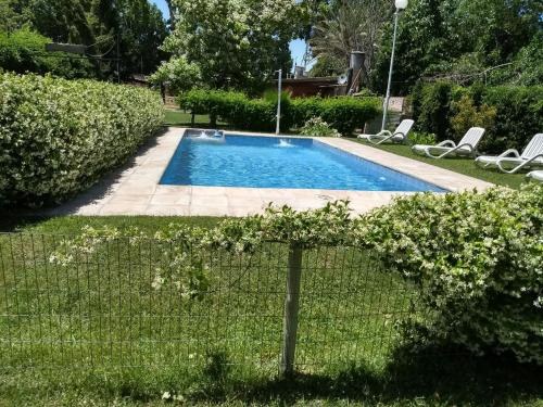 The swimming pool at or near Cabañas Perdriel