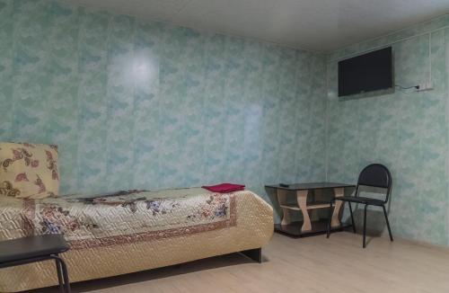 Кровать или кровати в номере Motel in Arkhipovka