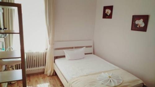 Ein Bett oder Betten in einem Zimmer der Unterkunft Hotel Ohm Patt