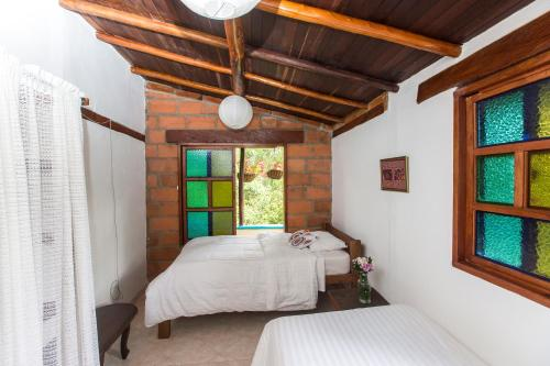 A bed or beds in a room at Eco Casa Raices