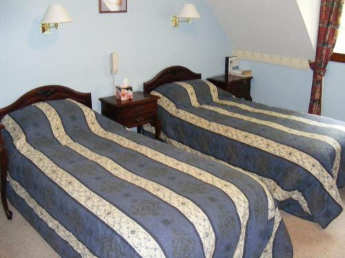 A bed or beds in a room at The Prince's House Hotel