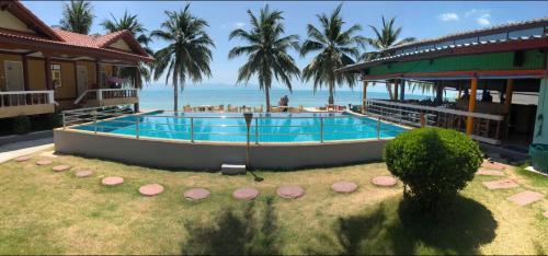 Piscine de l'établissement Sun Beach Bungalows ou située à proximité