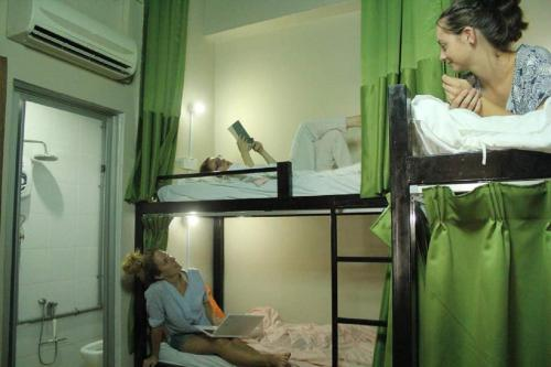 A bunk bed or bunk beds in a room at Birdnest Guesthouse, Gaia Rooftop Cafe