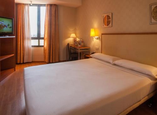 Cama o camas de una habitación en TH Boadilla