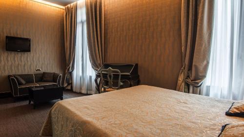 Letto o letti in una camera di Aqua Palace