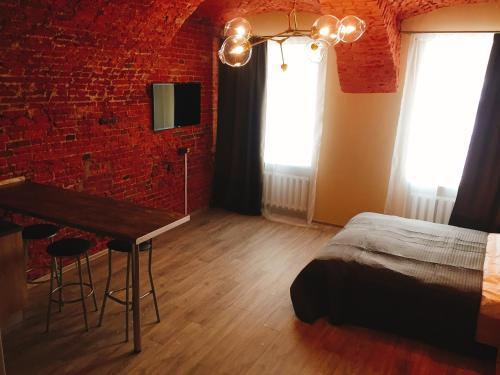 Телевизор и/или развлекательный центр в Апартаменты на Караванной №1