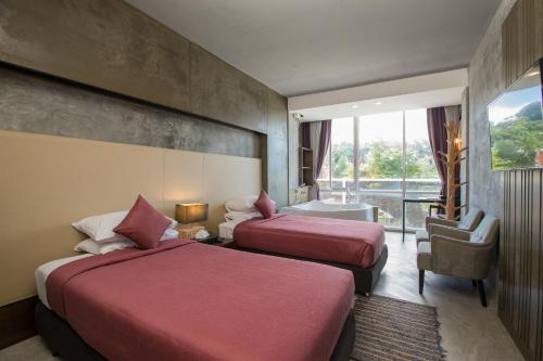 A bed or beds in a room at Patong Signature Boutique Hotel