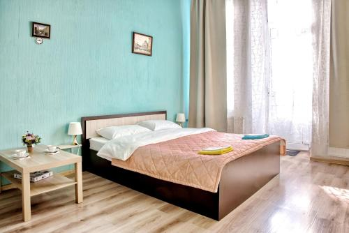 Кровать или кровати в номере Аве Питер