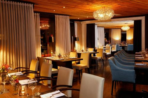 A restaurant or other place to eat at Hotel & Restaurant Schröder