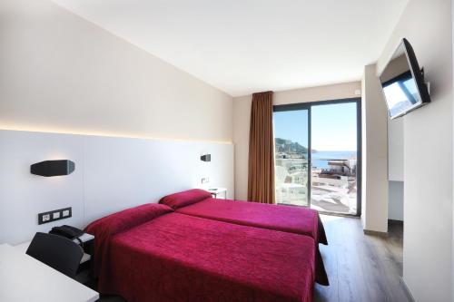 Cama o camas de una habitación en Hotel Alameda