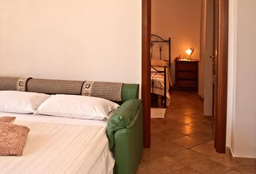 A bed or beds in a room at Agriturismo Sa Suerera