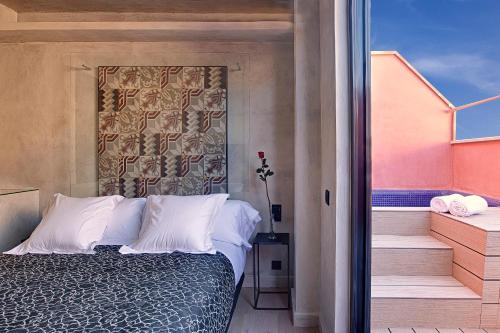 A bed or beds in a room at Aparthotel Arai 4* Superior