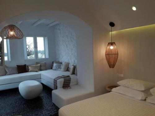 A bed or beds in a room at Faros Villa