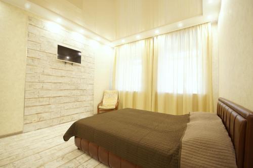 Кровать или кровати в номере SutkiSpb Mozhaiskaya 29