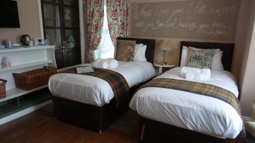 A bed or beds in a room at Hooray Henrys