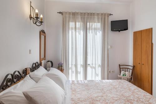 Ένα ή περισσότερα κρεβάτια σε δωμάτιο στο Ιλιάδα