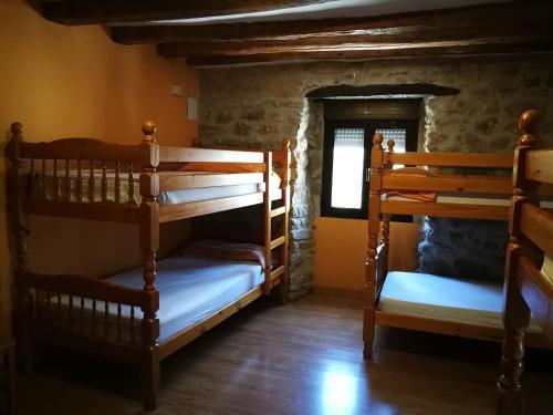 A bunk bed or bunk beds in a room at La Bodega Del Camino